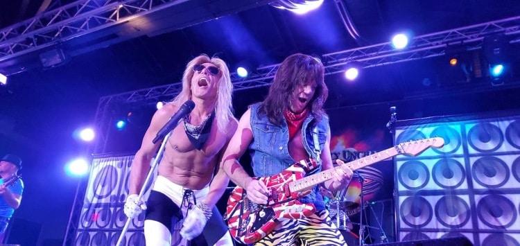 Two people who look like David Lee Roth and Eddie Van Halen