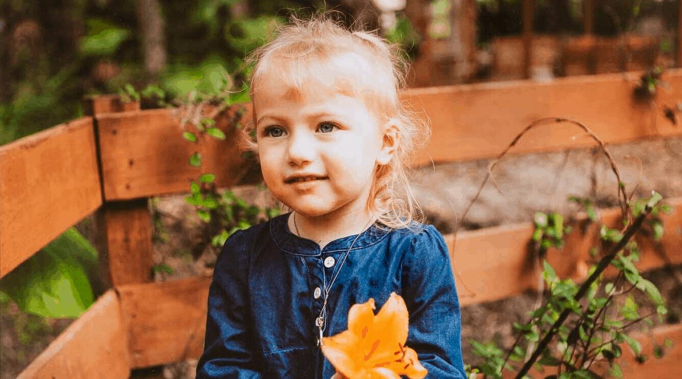 Photo of Ela holding a flower