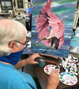 Mac MacMillan painting a Roseate Spoonbill
