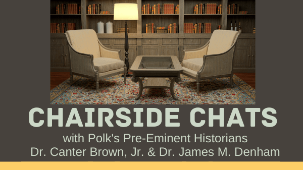 Two chairs in a library with a lamp. Says Chairside Chats with Polk's Pre-Eminent Historians Dr. Carter Brown, Jr & Dr. James M. Denham