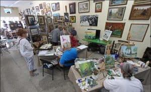 Members painting in Florida Wildflower Studios