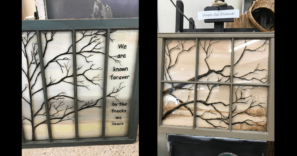Two windows with painted branches on them