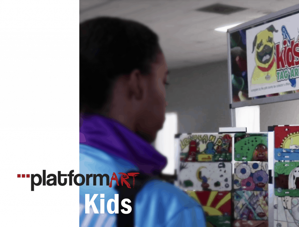 Platform Art Kids - Boy looking at Kids Art Display