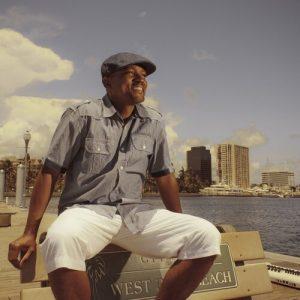 Greg Satterthwaite sitting on a bench in West Palm Beach