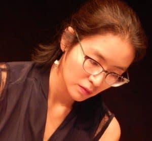 Woman pianist wearing glasses
