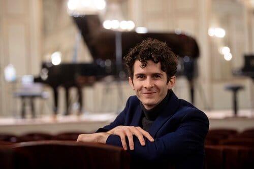 Robert Fleitz headshot with piano in background